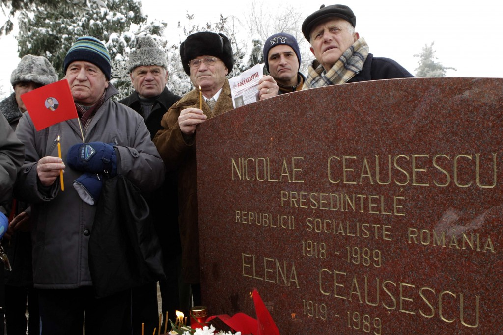 People listen to speeches at the grave of Romania's late Communist dictator Ceausescu in Bucharest
